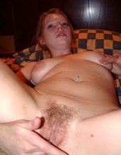Blond-haired exotic chick showing how she fingers her hairy pussy up close