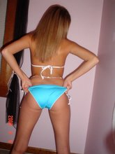 Blue lingerie cheerful blonde showing off her beautiful body on camera