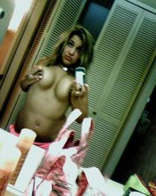 Pouty and trashy girl showing off her chubby body and perfect nipples