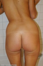 Brown-eyed blonde with massive breasts shows her wet naked body in the bathroom