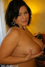 Luxurious and chubby brunette with natural tits showing them on camera