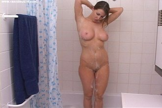 Short-haired and barely-legal brunette showing her nude body in the bathroom