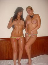 Two busty girlfriends playing around with each other half-naked