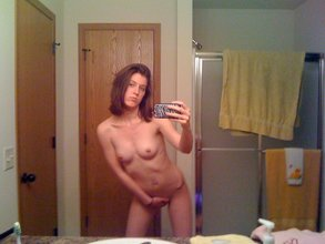 Skinny short-haired chick finger-blasts her tight hole