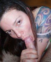 Tatted-up brunette girlfriend deepthroating her boyfriend's curved cock