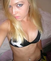 Blue-eyed blonde looks bitchy while showing off her incredible body