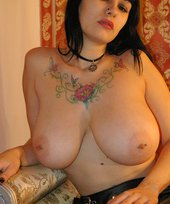 Dark-haired bombshell with natural tits showing off on camera