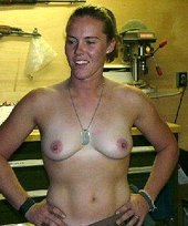 Military-loving hard-ass blonde showing her tits and posing with guns