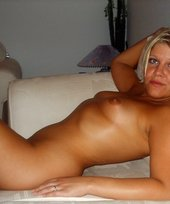 Tanned blonde with short hair showing off her amazing nude body