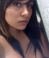 Pudgy dark-haired hottie showing her massive, MASSIVE breasts in the bathroom
