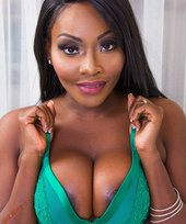 Long-legged ebony babe in a green bra gets fucked by a huge white cock