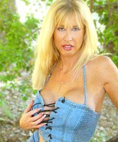 Denim-loving blond-haired beauty posing with her tits sticking out