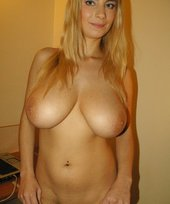 Blond-haired beauty with a huge rack shows these amazing tits for you