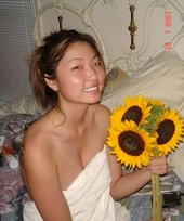 Dark-haired Asian seductress posing with her tits in the spotlight