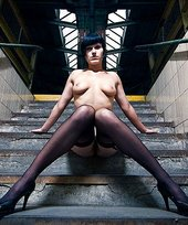 Skinny brunette with tiny tits flashing her naked body in an abandoned building