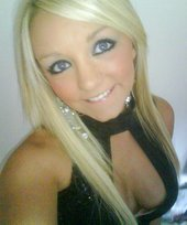 Blond-haired chav-like teen flashing her big tits in a black bra