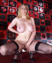Stockings-clad blonde teen with natural tits working the pole like a slut
