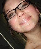 Glasses-wearing brunette walking around with a huge load on her face