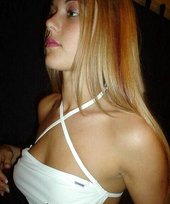 Blond-haired girlfriend with pokies showing off her lithe body on cam