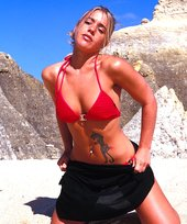 Athletic blonde is showing off her gorgeous tanned body on the beach