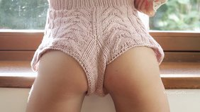 Cozy get-up wavy-haired brunette shows her pretty pussy by the window