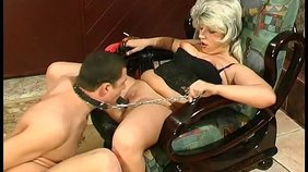 Blond-haired MILF (it's not a wig!) dominating her younger lover on cam