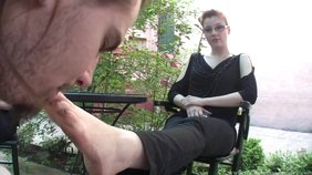 Redheaded chick with sexy glasses gets to humiliate a guy outdoors
