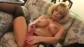 Frisky blonde in provocative lingerie is smoking and masturbating