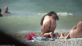 Curly-haired nudist shows her pussy on all fours