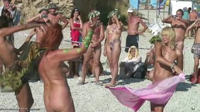 Nudist beauties enjoy themselves a dance contest