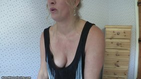 Mature blonde wife with wavy hair showing off her impressive knockers