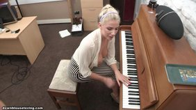 Busty blonde's tits fall out while she's playing the piano on camera