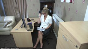Glasses-wearing office blonde flashing her tits in front of the computer