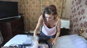 Skinny brunette packing her clothes while showing a bit of her tits