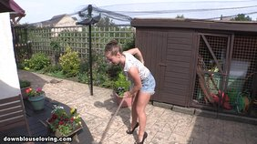 Denim shorts brown-haired hottie doing yard work and looking hot