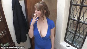 Blue get-up brown-haired bombshell flashing her tit while smoking