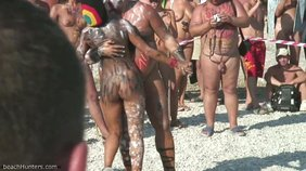 Tribal-like dancing with an extremely tanned brunette girlfriend