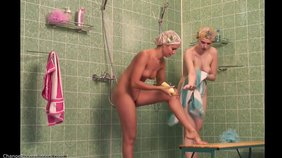 Two wet and naked hotties show off in the shower