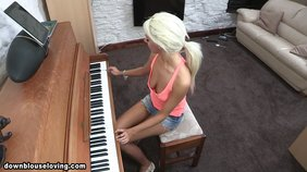 Ponytailed blonde in denim shorts plays the piano and acts real naughty