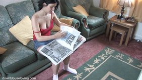 White socks dark-haired GF flips through a magazine with her tits out
